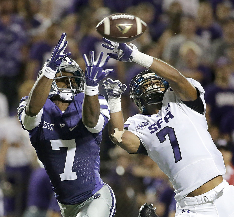 Photo - Stephen F. Austin defensive back Hipolito Coporan, right, breaks up a pass intended for Kansas State wide receiver Judah Jones, left, during the second half of an NCAA college football game Saturday, Aug. 30, 2014, in Manhattan, Kan. (AP Photo/Charlie Riedel)