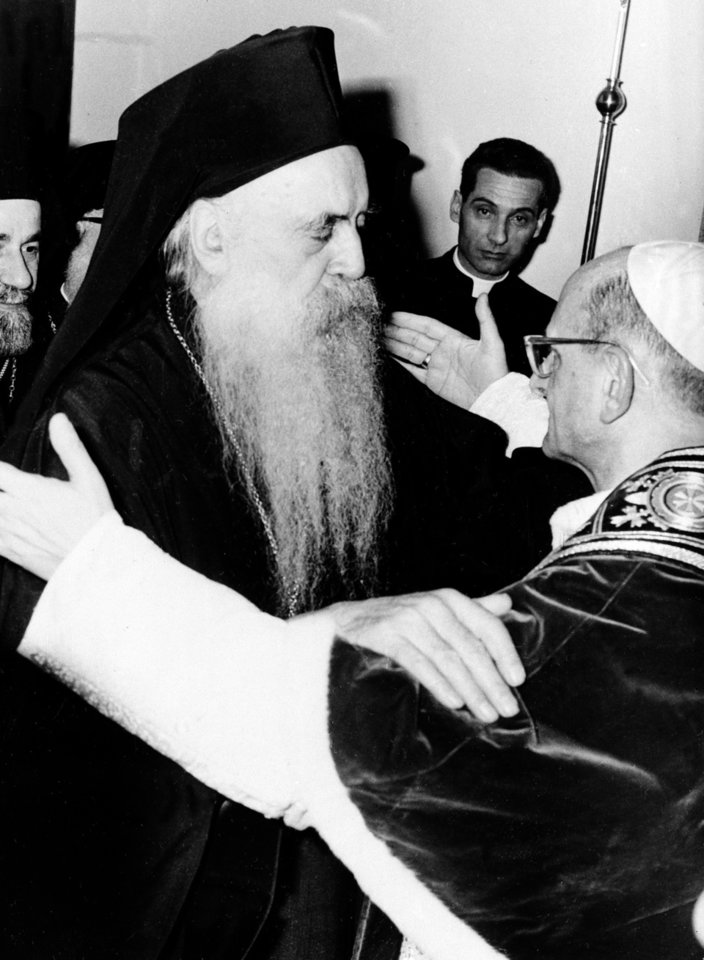 "Photo - FILE -- In this file photo taken on Jan. 5, 1964, Pope Paul VI, right, and orthodox Patriarch Athenagoras of Constantinople embrace at their historic meeting at the apostolic delegation's headquarters on the Mount of Olives in Jerusalem, Jordan. The iconic 1964 embrace between the diminutive Paul and the six-foot-tall, bearded Patriarch of Constantinople ended 900 years of mutual excommunications and divisions between Catholic and Orthodox stemming from the Great Schism of 1054, which split Christianity. Pope Francis insists his weekend pilgrimage to the Middle East is a ""strictly religious"" commemoration of a key turning point in Catholic-Orthodox relations. But the three-day visit is the most delicate mission of his papacy and will test his diplomatic chops as he negotiates Israeli-Palestinian tensions and fallout from Syria's civil war. (AP Photo)"