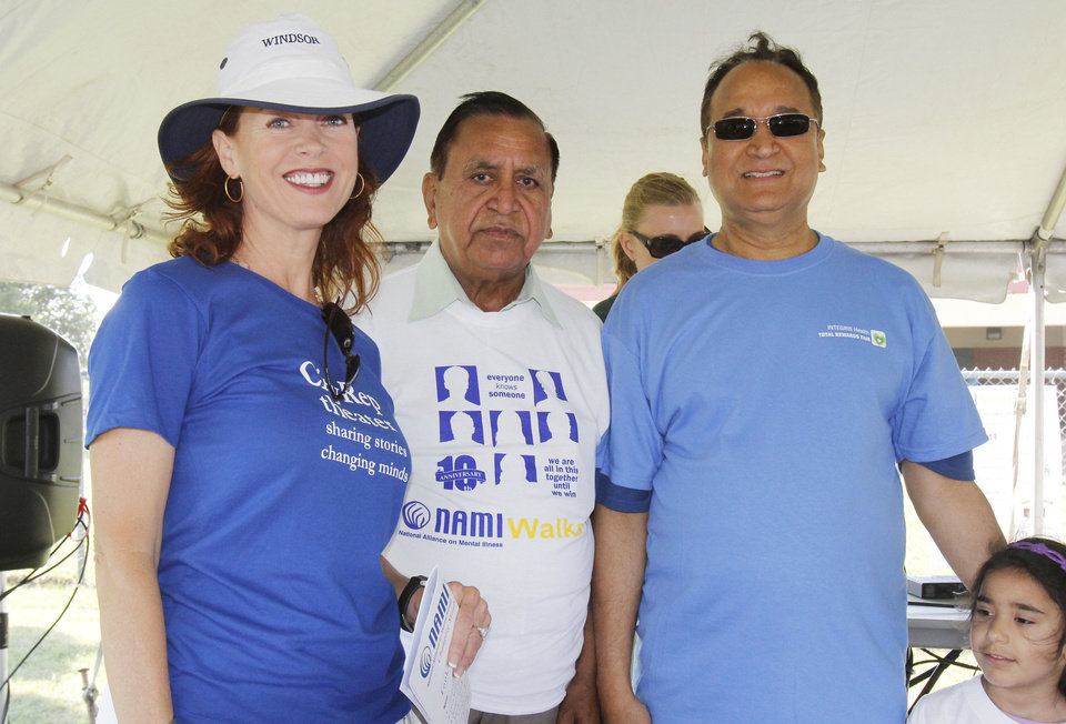 Photo - Actress Stacey Logan-Lewis, Kailash Sachdeva, and Dr. R. Murali Krishna participate in the National Alliance on Mental Illness walk Saturday in Oklahoma City. Photo By Paul Hellstern, The Oklahoman