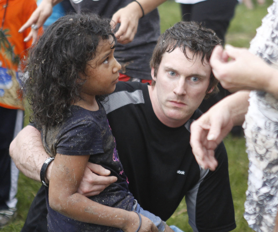 A man comforts a child at Briarwood Elementary school after a tornado destroyed the school in south OKC Oklahoma City, OK, Monday, May 20, 2013. Near SW 149th and Hudson.  By Paul Hellstern, The Oklahoman