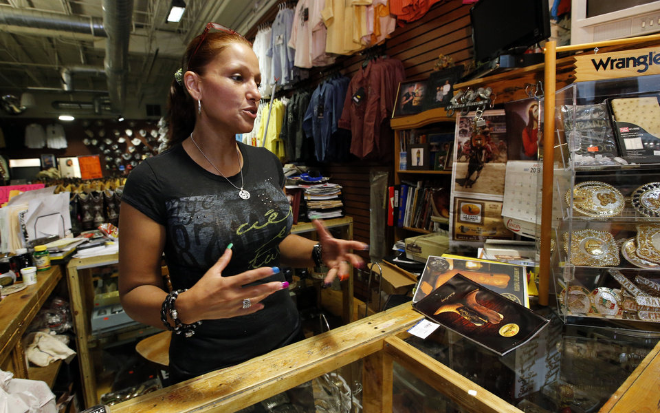 Esmeralda Mendoza talks about her western wear store in Plaza Mayor on Tuesday. Photo by Steve Sisney, The Oklahoman <strong>STEVE SISNEY - THE OKLAHOMAN</strong>