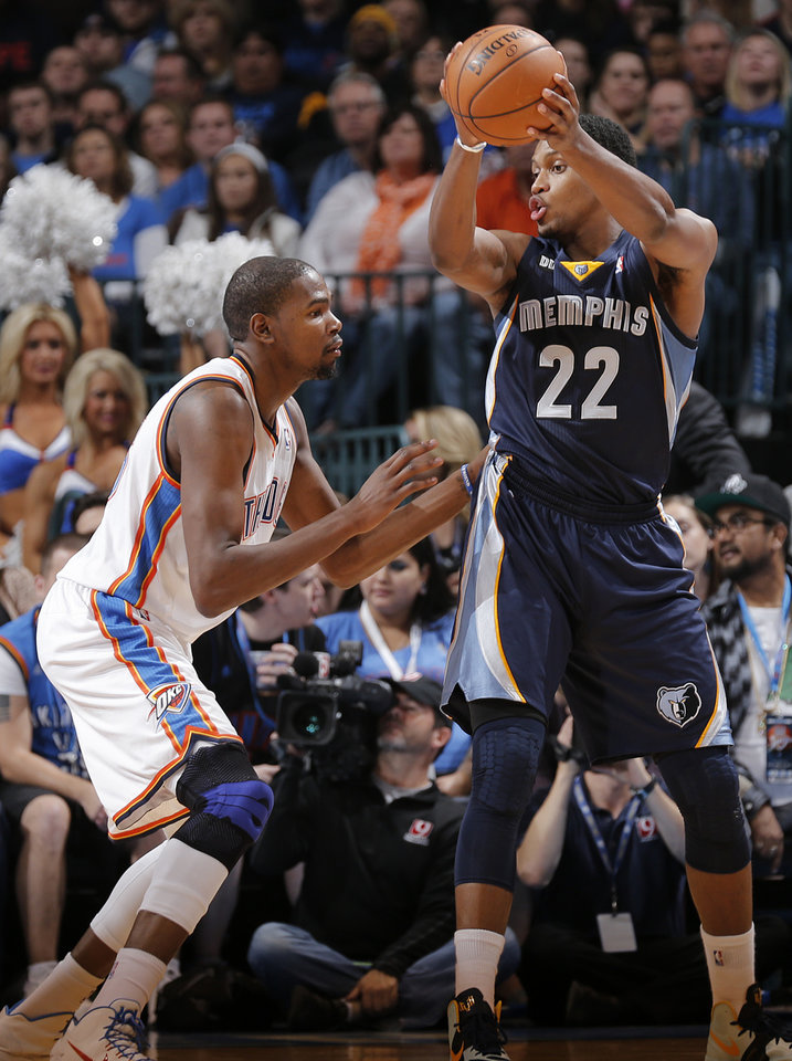 Photo - Oklahoma City's Kevin Durant (35) defends on Memphis' Rudy Gay (22) during the NBA basketball game between the Oklahoma City Thunder and the Memphis Grizzlies at Chesapeake Energy Arena on Wednesday, Nov. 14, 2012, in Oklahoma City, Okla.   Photo by Chris Landsberger, The Oklahoman