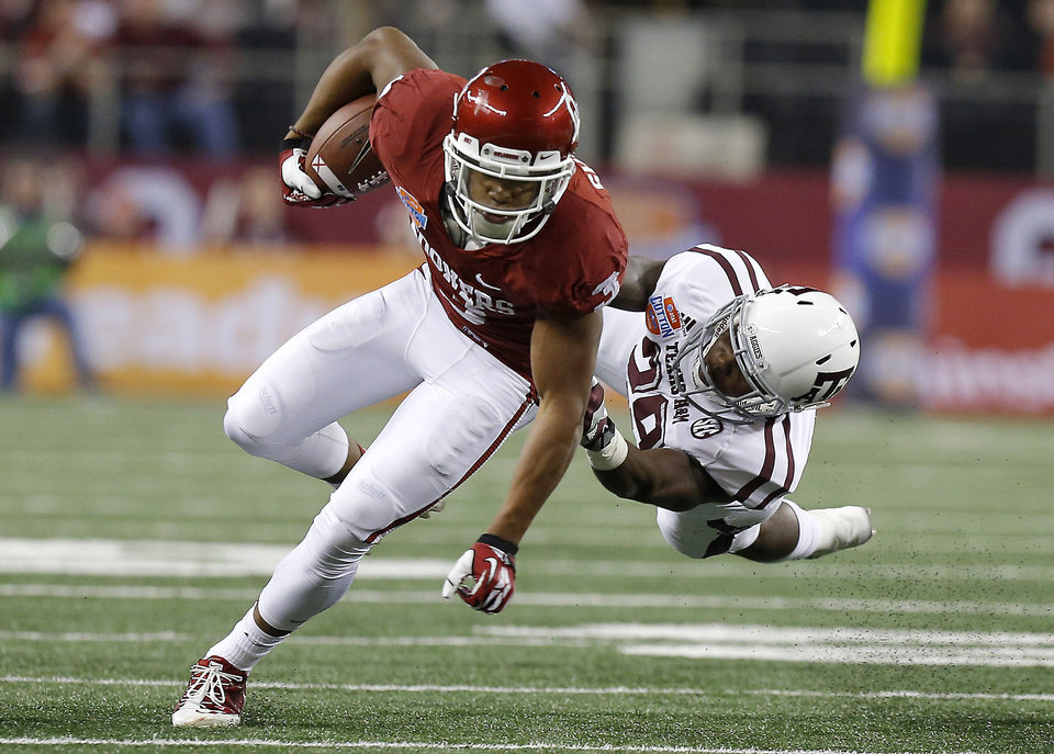 Oklahoma\'s Sterling Shepard (3) tries to get past Texas A&M \'s Deshazor Everett (29) during the Cotton Bowl college football game between the University of Oklahoma (OU)and Texas A&M University at Cowboys Stadium in Arlington, Texas, Friday, Jan. 4, 2013. Photo by Bryan Terry, The Oklahoman