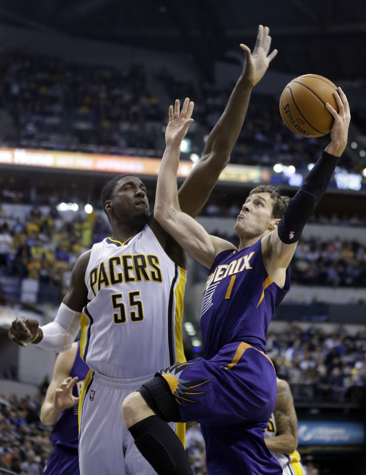 Photo - Phoenix Suns guard Goran Dragic, right, shoots under Indiana Pacers center Roy Hibbert in the first half of an NBA basketball game in Indianapolis, Thursday, Jan. 30, 2014. (AP Photo)