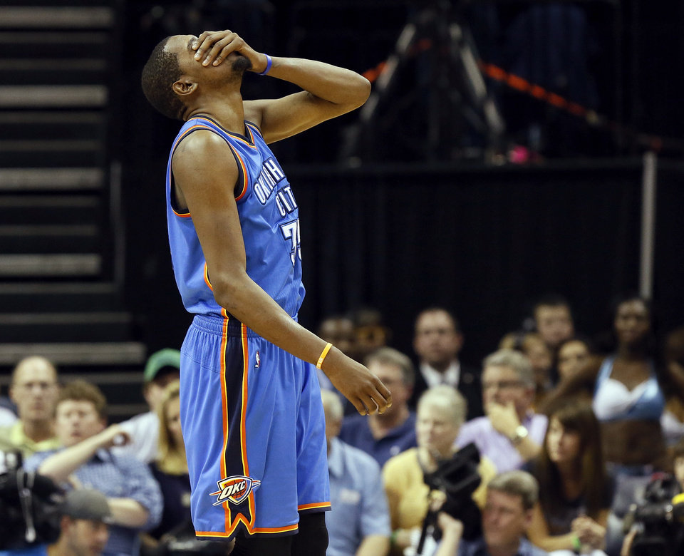 Photo - Oklahoma City's Kevin Durant (35) reacts after being hit in the face on a play during Game 3 in the second round of the NBA basketball playoffs between the Oklahoma City Thunder and Memphis Grizzles at the FedExForum in Memphis, Tenn., Saturday, May 11, 2013. Memphis won, 87-81. Photo by Nate Billings, The Oklahoman