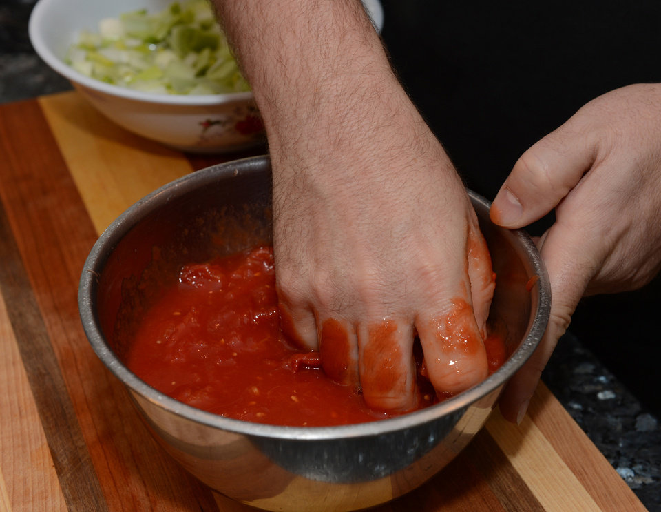 Preparing authentic Italian tomato sauce is a very important step in making the Italian Fish Soup. (Johnny Crawford/Atlanta Journal-Constitution/MCT)