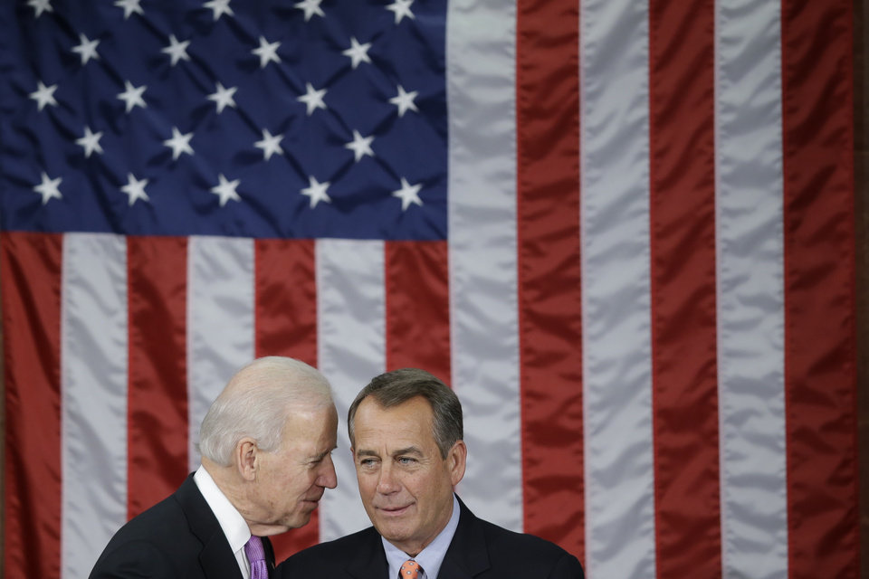 Photo - Vice President Joe Biden talks with House Speaker John Boehner of Ohio before President Barack Obama's State of the Union address during a joint session of Congress on Capitol Hill in Washington, Tuesday Feb. 12, 2013. (AP Photo/Pablo Martinez Monsivais)