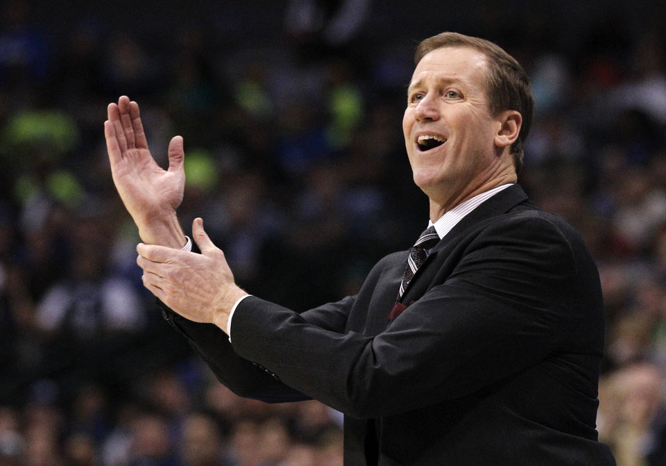 Photo -   Portland Trail Blazers head coach Terry Stotts looks from the officials during the first half of an NBA basketball game against the Dallas Mavericks, Monday, Nov. 5, 2012, in Dallas. (AP Photo/Tony Gutierrez)