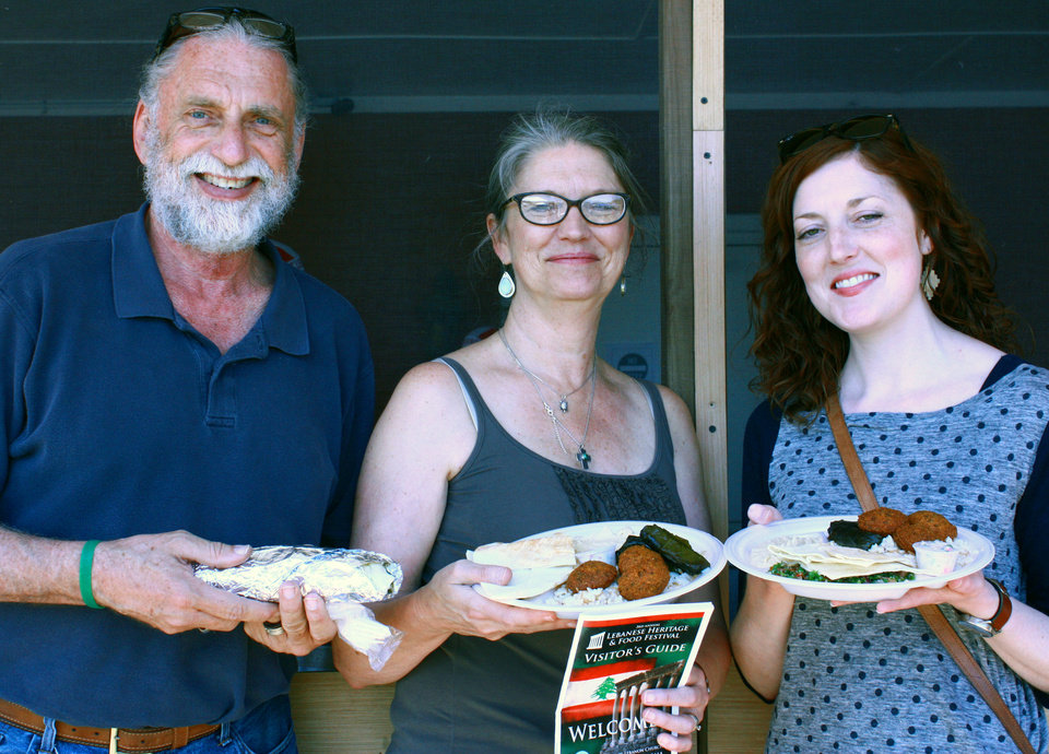 Photo -  Dave and Pam Boeck, with daughter Katy Knight, hold plates of traditional Lebanese food at the third annual Lebanese Heritage and Food Festival at Our Lady of Lebanon Church in Norman. PHOTO BY LYNETTE LOBBAN, FOR THE OKLAHOMAN
