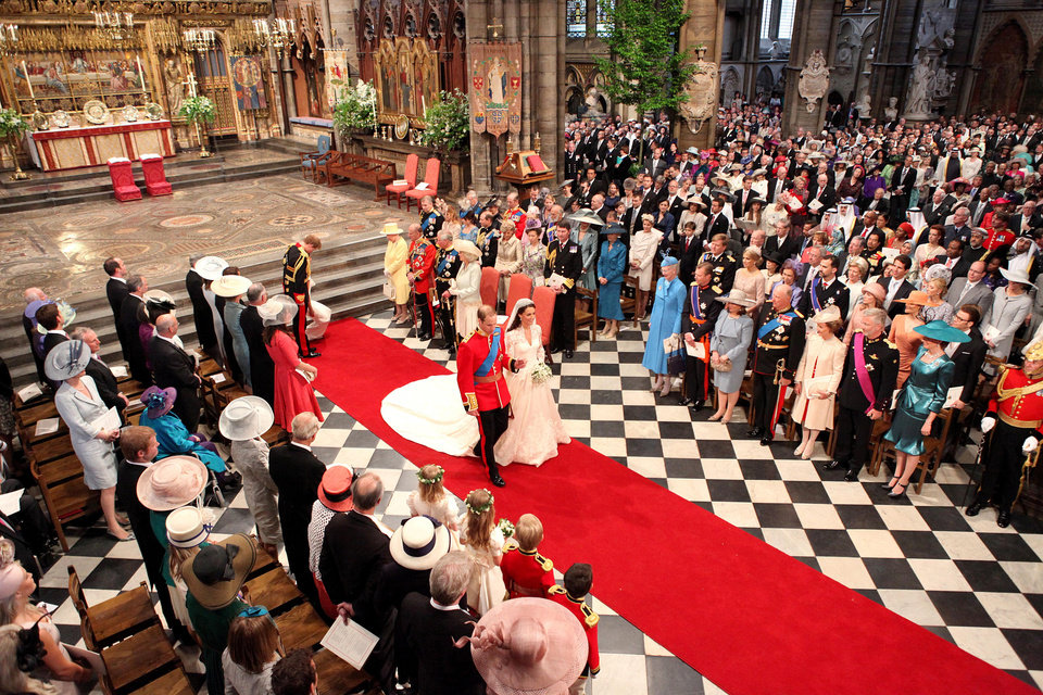 Photo - Britain's Prince William and Kate, the Duchess of Cambridge walk, down the aisle after their wedding service at Westminster Abbey, London, Friday April 29, 2011. (AP Photo/Dominic Lipinski, Pool)  ORG XMIT: RWDJ119