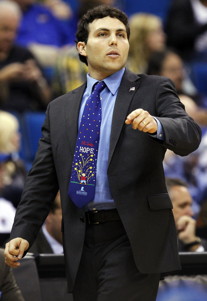 Photo - Memphis coach Josh Pastner gives instructions to his team in the first half during the NCAA men's basketball tournament second round game between Arizona and Memphis at the BOK Center in Tulsa, Okla., Friday, March 18, 2011. Photo by Nate Billings, The Oklahoman