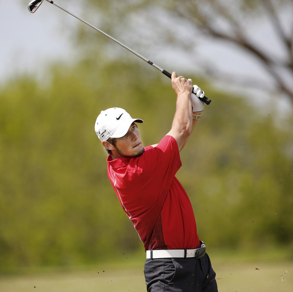 Photo - Elk City's Berek Dyson hits a  shot during Class 4A boy's state golf  tournament on Tuesday, May 7, 2013,  at  Hefner Golf Course in Oklahoma City.   Photo  by Jim Beckel, The Oklahoman.