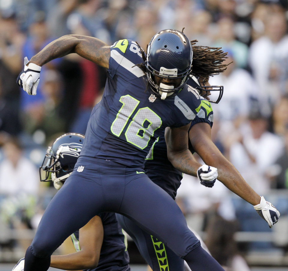 Photo -   Seattle Seahawks' Sidney Rice celebrates a play with a teammate against the Oakland Raiders in the first half of a preseason NFL football game Thursday, Aug. 30, 2012 in Seattle. (AP Photo/Stephen Brashear)