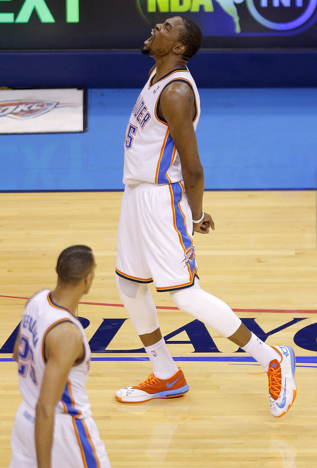 Photo - Oklahoma City's Kevin Durant (35) celebrates after making a basket late in the fourth quarter during Game 2 in the first round of the NBA playoffs between the Oklahoma City Thunder and the Memphis Grizzlies at Chesapeake Energy Arena in Oklahoma City, Monday, April 21, 2014. Photo by Sarah Phipps, The Oklahoman