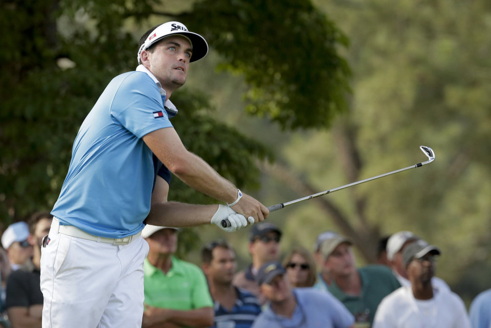 Photo - Keegan Bradley watches his tee shot on the 17th hole during the first round of the U.S. Open golf tournament in Pinehurst, N.C., Thursday, June 12, 2014. (AP Photo/Charlie Riedel)