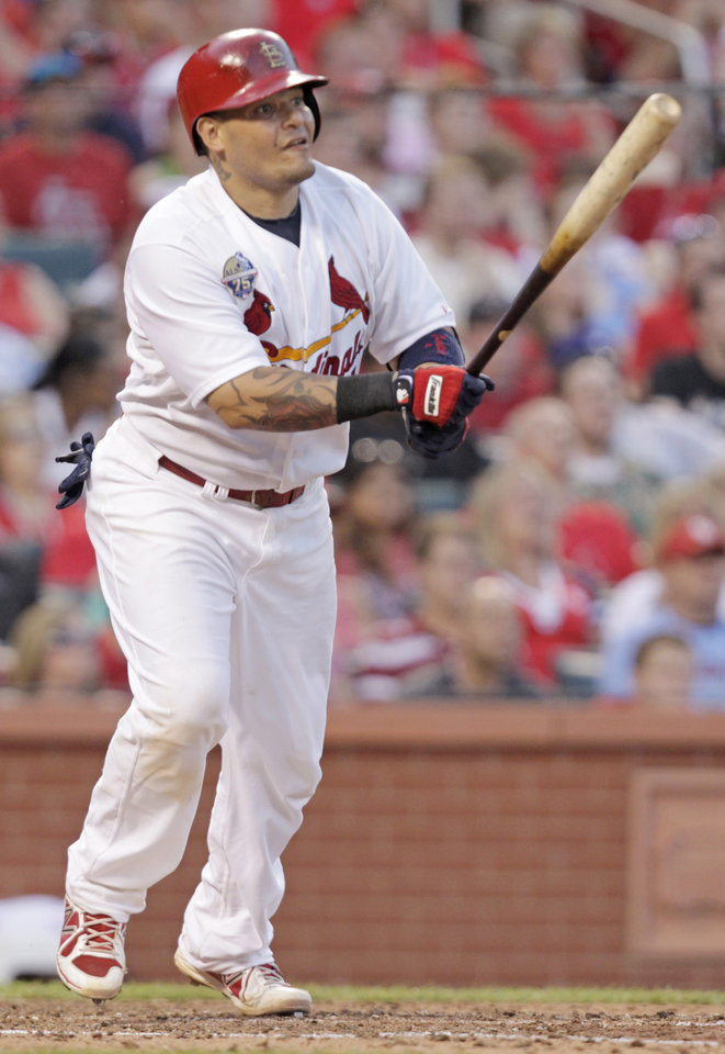 Photo - St. Louis Cardinals' Yadier Molina watches his RBI-double in the sixth inning of a baseball game against the Miami Marlins, Friday, July 4, 2014, in St. Louis.(AP Photo/Tom Gannam)