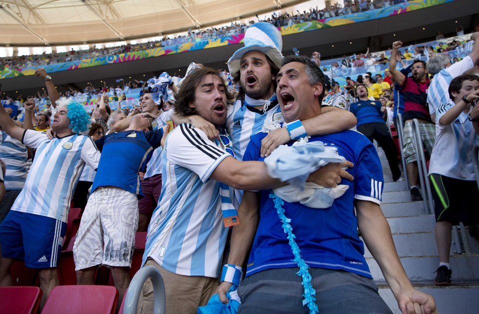 Photo - Argentina soccer fans celebrate their team's World Cup quarterfinal victory over Belgium at the Estadio Nacional, in Brasilia, Brazil Saturday, July 5, 2014. Gonzalo Higuain's first goal of this World Cup sent Argentina into the semifinals on Saturday with a 1-0 win over Belgium. (AP Photo/Rodrigo Abd)