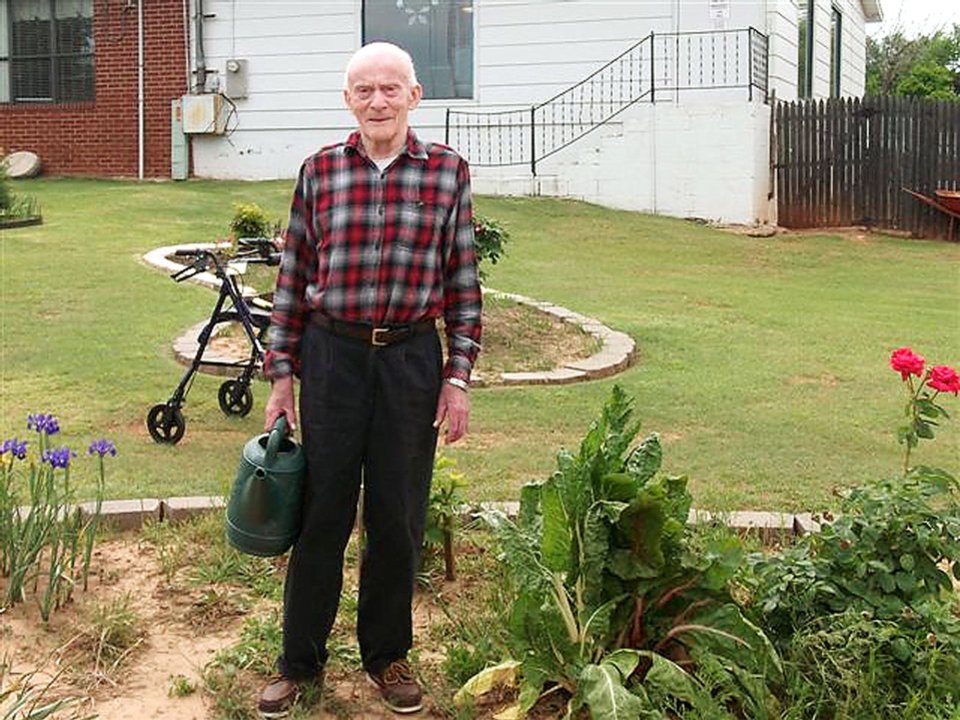 Photo - Forrest Hill tends the gardens at Grace Living Center-Wilshire, where he is a  resident. Photo provided
