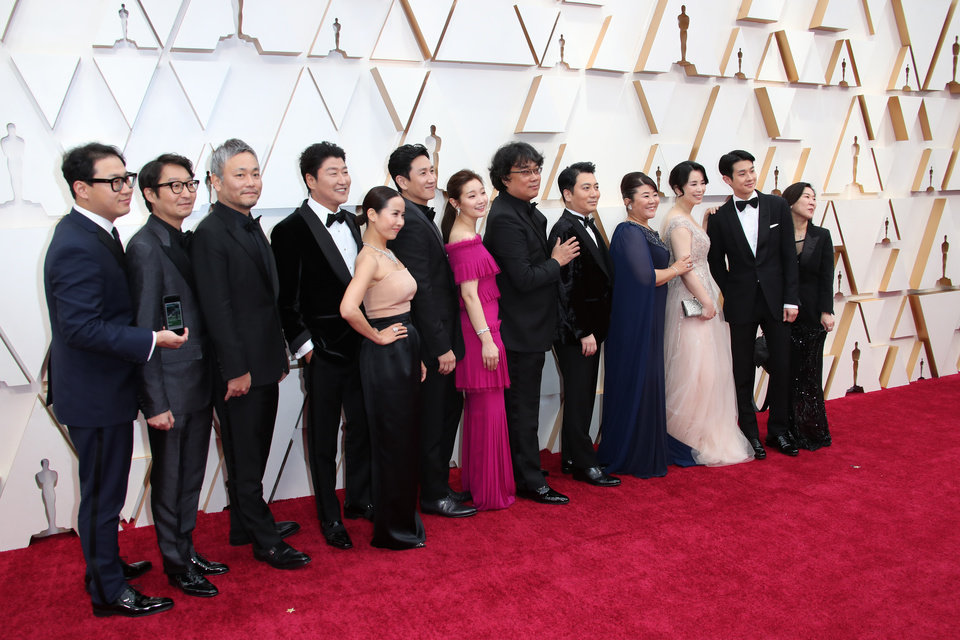 Photo - Feb 9, 2020; Los Angeles, CA, USA;  Bong Joon Ho, center, and the Cast and Crew of Parasite arrive at the 92nd Academy Awards at Dolby Theatre. Mandatory Credit: Dan MacMedan-USA TODAY
