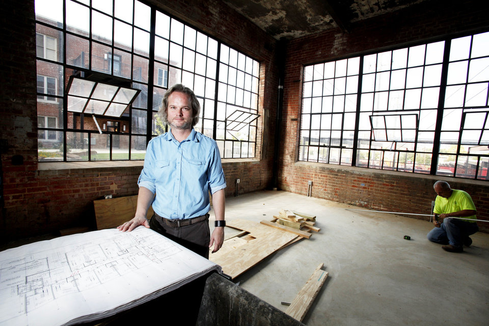 Architect Brian Fitzsimmons looks over plans for the Guardian Apartments. Photo by Steve Gooch, The Oklahoman