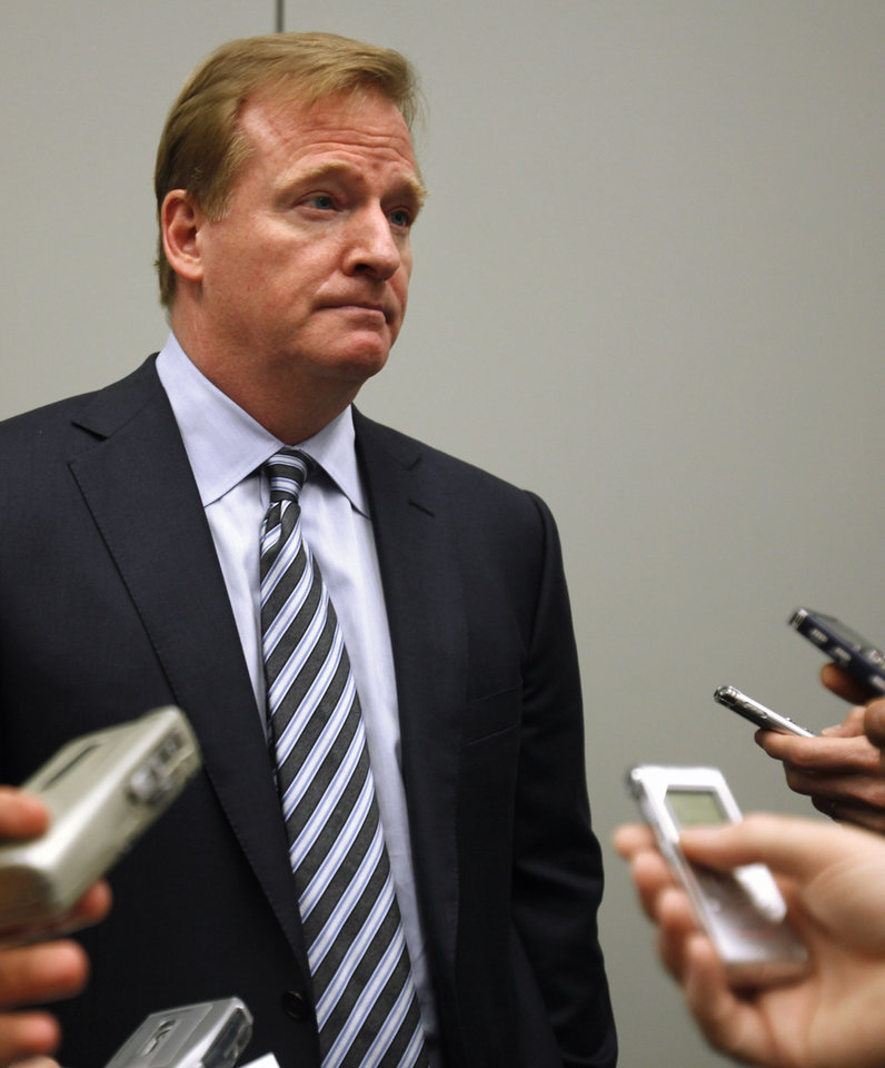 Photo -   FILE - This Oct. 3, 2011 file photo shows NFL football Commissioner Roger Goodell speaking to reporters after speaking about concussions at the Congress of Neurological Surgeons, in Washington. A concussion-related lawsuit bringing together scores of cases has been filed in federal court, accusing the NFL of hiding information that linked football-related head trauma to permanent brain injuries. (AP Photo/Jacquelyn Martin, File)