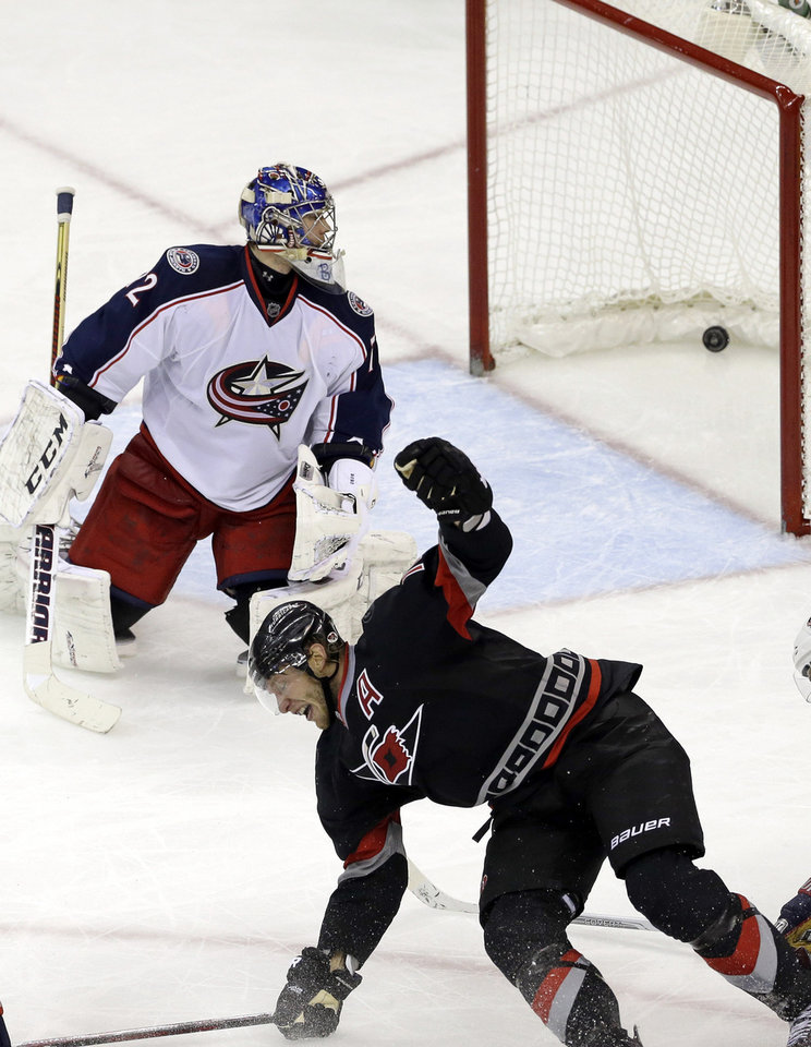 Photo - Carolina Hurricanes' Jordan Staal celebrates his game-winning goal against Columbus Blue Jackets goalie Sergei Bobrovsky, of Russia, during the third period of an NHL hockey game in Raleigh, N.C., Monday, Jan. 27, 2014. Carolina won 3-2. (AP Photo/Gerry Broome)