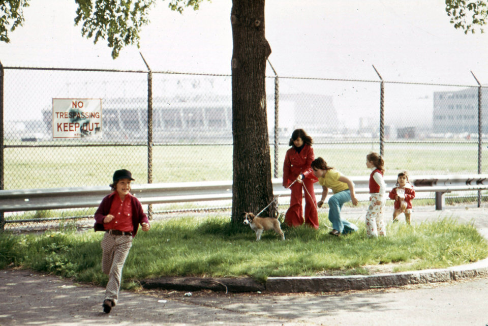 This May 1973 photo released by the U.S. National Archives shows neighborhood youngsters in the playground adjacent to Logan Airport at the end of Neptune Road in the East Boston neighborhood of Boston. The photo was taken for the
