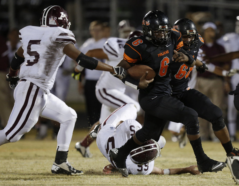 Douglass\'s Johnny Jones (6) runs the ball during a high school football game between Douglass and Ada at Moses F. Miller Stadium in Oklahoma City, Friday, Nov. 2, 2012. Photo by Garett Fisbeck, The Oklahoman