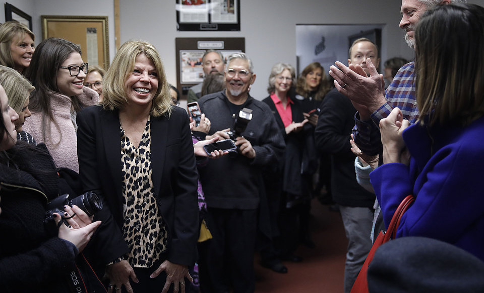 Photo - Rhonda Bear(left) reacts as a crowded She Brews Coffee House cheers for her as they wait for Oklahoma Gov. Kevin Stitt to arrive and sign  her pardon in Claremore Thursday, Nov. 7, 2019. MIKE SIMONS/Tulsa World