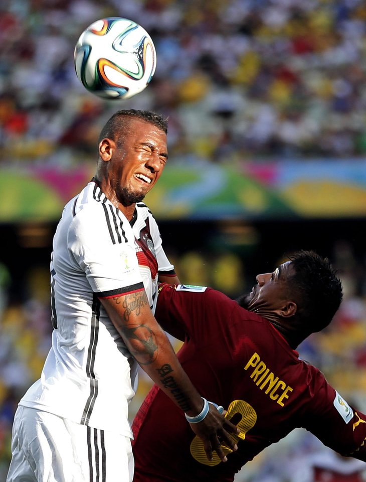 Photo - Ghana's Kevin-Prince Boateng, right, challenges Germany's Jerome Boateng during the group G World Cup soccer match at the Arena Castelao in Fortaleza, Brazil, Saturday, June 21, 2014. (AP Photo/Matthias Schrader)