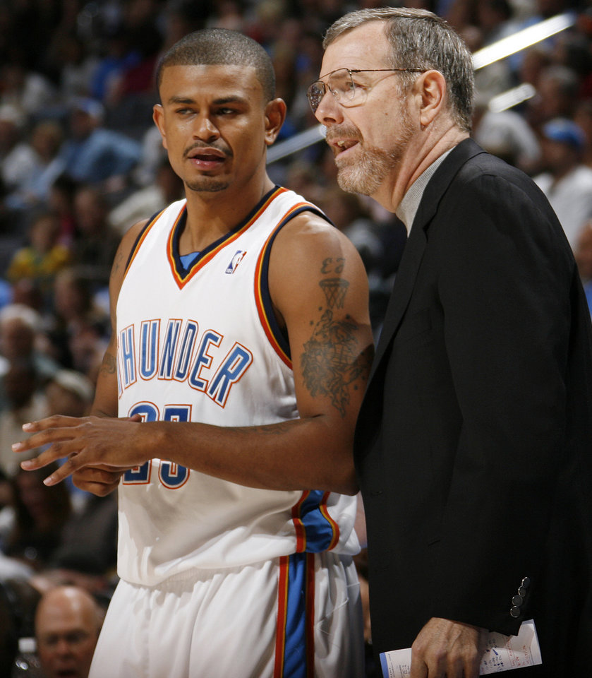 Photo - Earl Watson of the Thunder talks to head coach P.J. Carlesimo in the first half of the NBA basketball game between the Oklahoma City Thunder and the Los Angeles Clippers at the Ford Center in Oklahoma City, Wednesday, Nov. 19, 2008. BY NATE BILLINGS, THE OKLAHOMAN