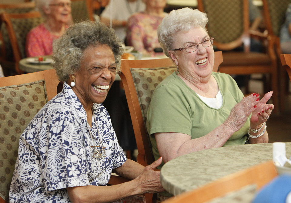 Residents Pat Cambor (left) and Judy Maggard enjoy the show as the Cottonwood Creek Cloggers perform for residents at Fountain Brook Assisted Living in Midwest City, OK, Thursday, July 19, 2012, By Paul Hellstern, The Oklahoman