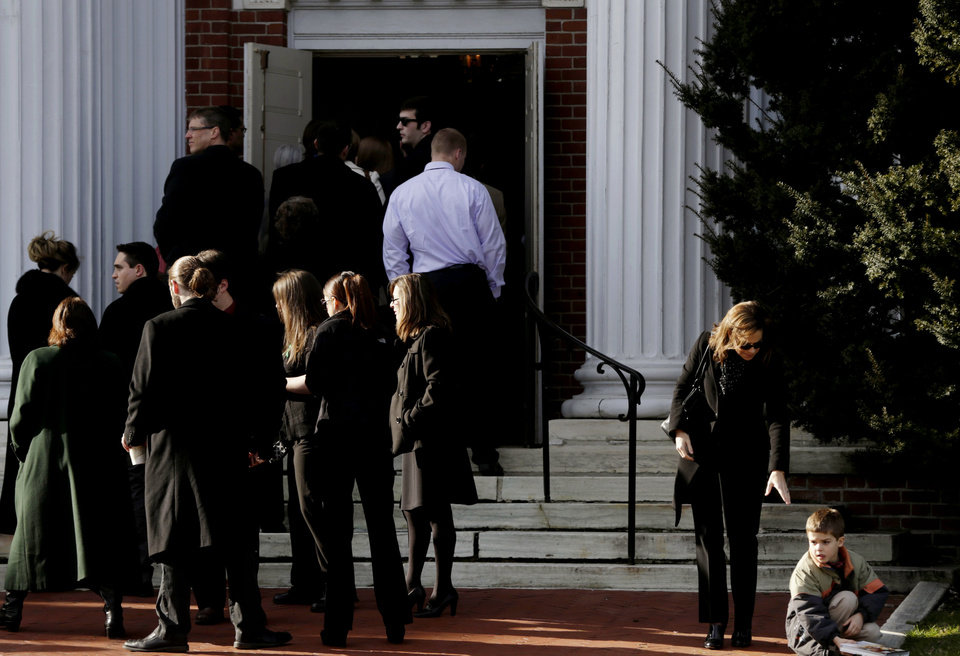 A woman offers her hand to a boy before entering a church for the memorial service for Lauren Rousseau in Danbury, Conn., Thursday, Dec. 20, 2012.   Rousseau, 30, was killed when Adam Lanza walked into Sandy Hook Elementary School in Newtown, Dec. 14, and opened fire, killing 26 people, including 20 children, before killing himself.  (AP Photo/Seth Wenig)