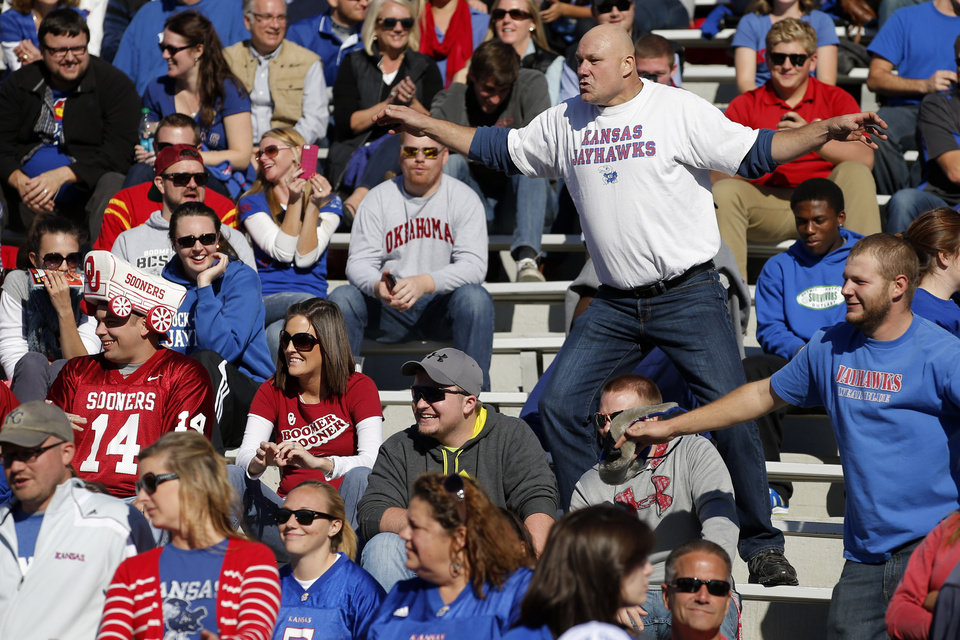 Photo - Kansas fans celebrate an early lead during the college football game between the University of Oklahoma Sooners (OU) and the University of Kansas Jayhawks (KU) at Memorial Stadium in Lawrence, Kan., Saturday, Oct. 19, 2013. Oklahoma won 34-19. Photo by Bryan Terry, The Oklahoman