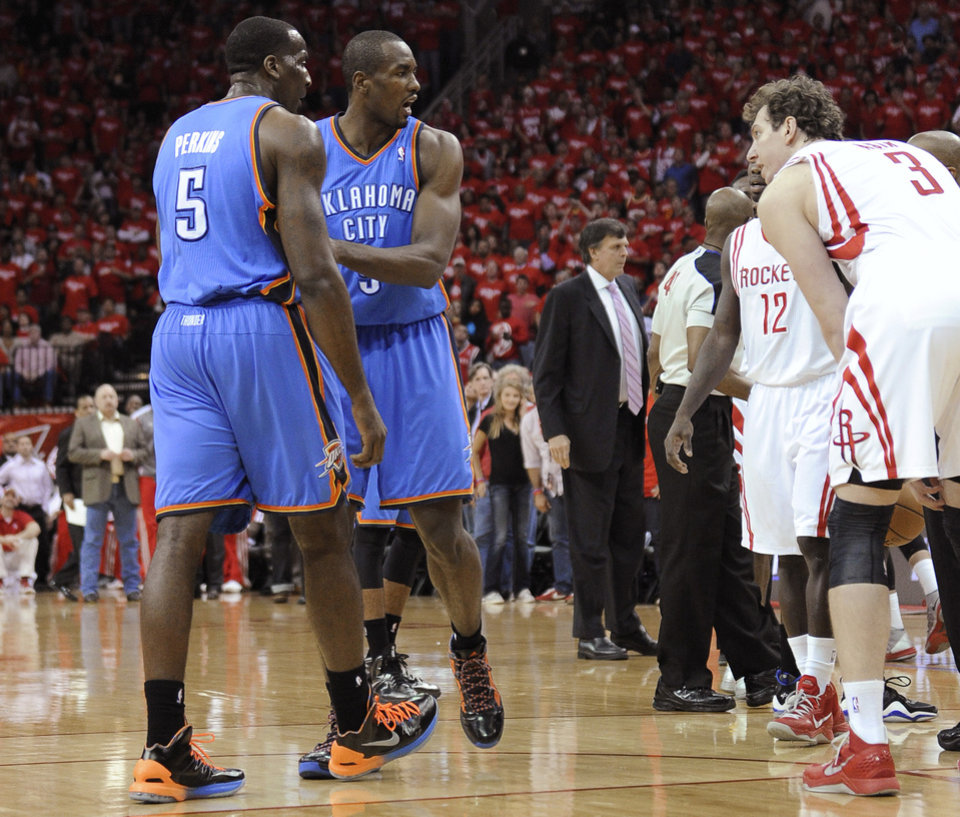 Oklahoma City Thunder's Kendrick Perkins (5) and Serge Ibaka, center, exchange words with Houston Rockets' Omer Asik (3) in the first quarter of Game 6 in a first-round NBA basketball playoff series Friday, May 3, 2013, in Houston. (AP Photo/Pat Sullivan)