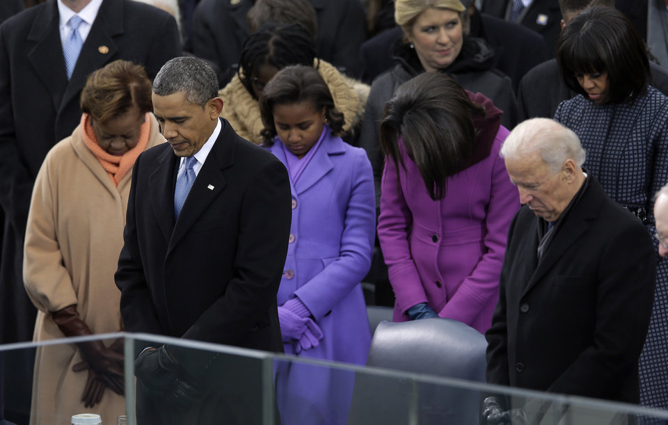 Photo - President Barack Obama and Vice President Joe Biden listen to the benediction at the ceremonial swearing-in at the U.S. Capitol during the 57th Presidential Inauguration in Washington, Monday, Jan. 21, 2013. (AP Photo/Carolyn Kaster)