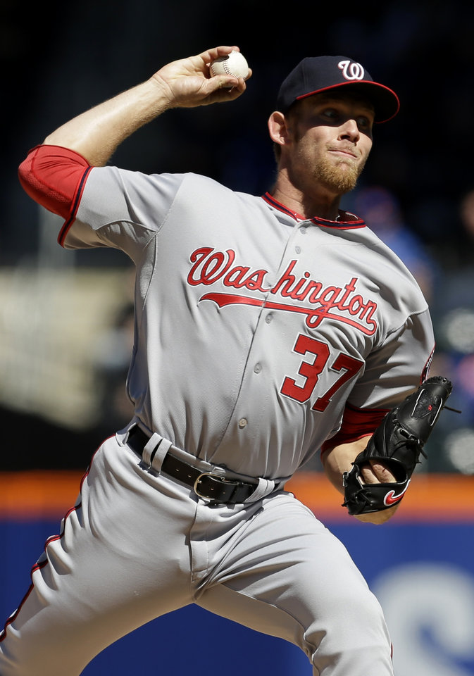 Photo - Washington Nationals starting pitcher Stephen Strasburg throws during the third inning of the baseball game against the New York Mets on opening day at Citi Field in New York, Monday, March 31, 2014.  (AP Photo/Seth Wenig)