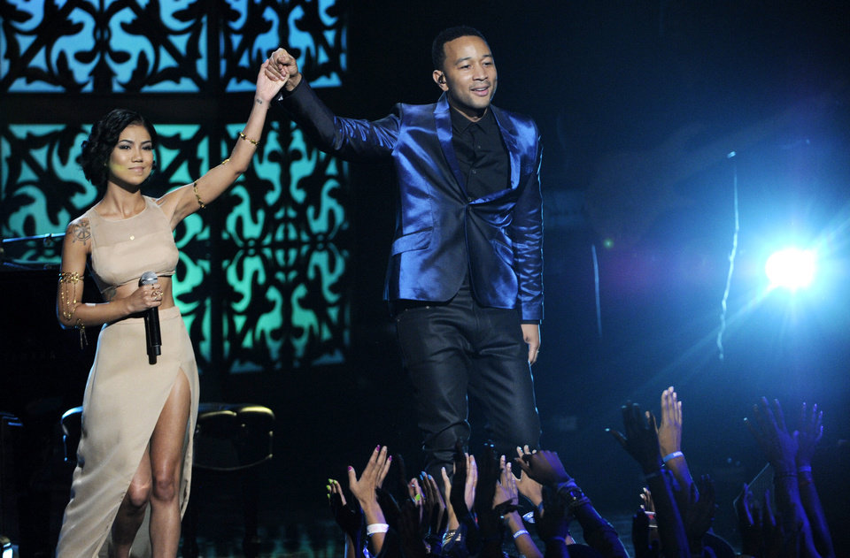 Photo - Jhene Aiko, left, and John Legend perform at the BET Awards at the Nokia Theatre on Sunday, June 29, 2014, in Los Angeles. (Photo by Chris Pizzello/Invision/AP)