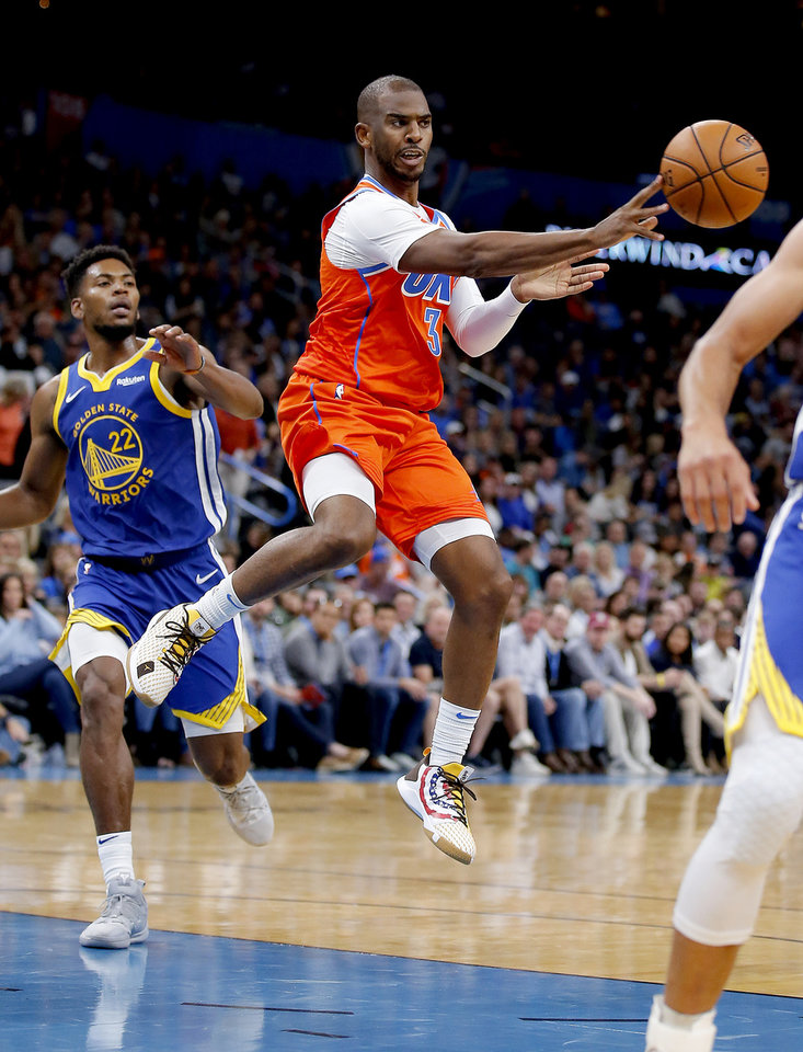 Photo - Oklahoma City's Chris Paul (3) pass the ball during the NBA game between the Oklahoma City Thunder and Golden State Warriors at Chesapeake Energy Arena,  Sunday, Oct. 27, 2019. Thunder won 120-92.[Sarah Phipps/The Oklahoman]