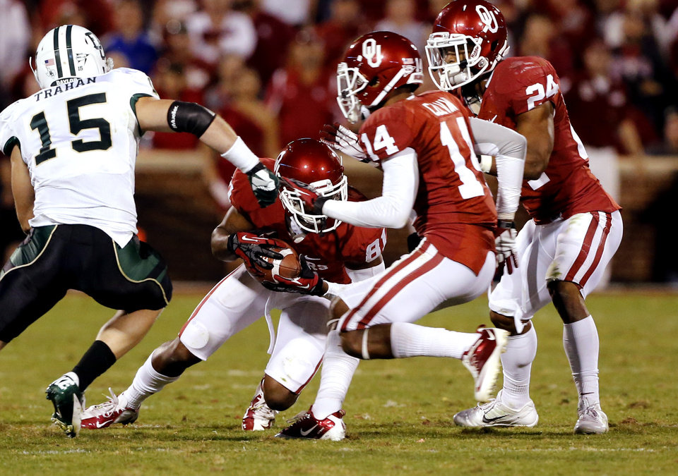 Oklahoma Sooners's Lacoltan Bester (81) recovers an onside kick during the the second half of the college football game where  the University of Oklahoma Sooners (OU) defeated the Baylor University Bears (BU) 42-34 at Gaylord Family-Oklahoma Memorial Stadium in Norman, Okla., Saturday, Nov. 10, 2012.  Photo by Steve Sisney, The Oklahoman