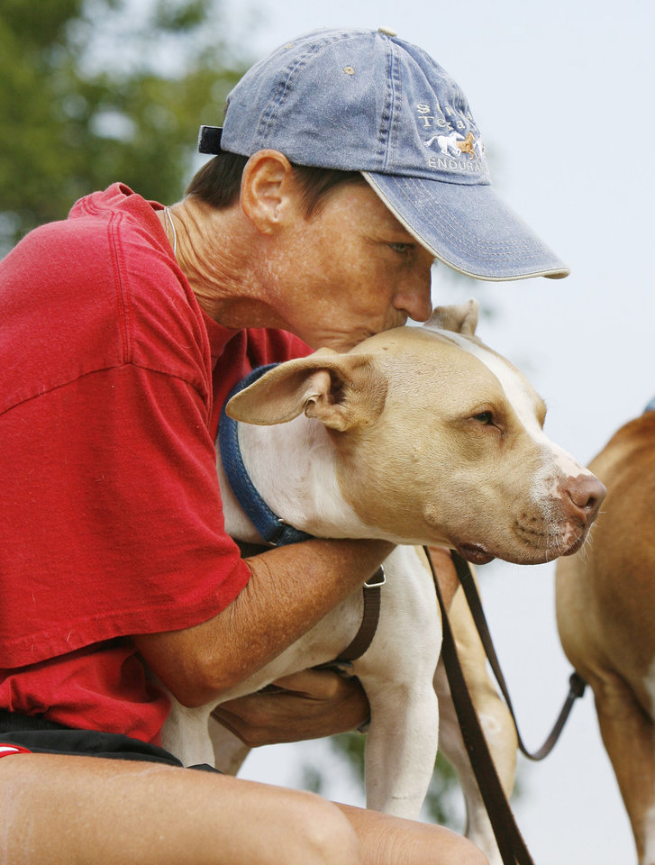 Photo - DOG: Molly Gibb hugs her pit bull terrier Alf at Stars and Stripes Park in Oklahoma City, OK, Saturday, Sept. 6, 2008. BY PAUL HELLSTERN, THE OKLAHOMAN ORG XMIT: KOD