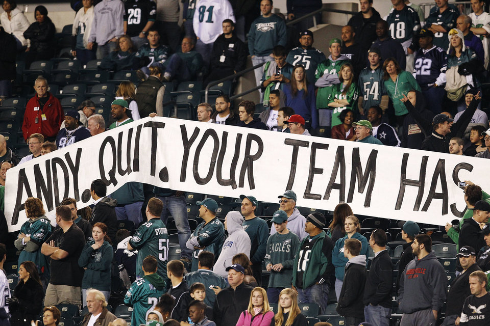 Philadelphia Eagles fans hold up a sign in the second half of an NFL football game against the Dallas Cowboys, Sunday, Nov. 11, 2012, in Philadelphia. Dallas won 38-23. (AP Photo/Philadelphia Daily News, David Maialetti) THE EVENING BULLETIN OUT, TV OUT; MAGS OUT; NO SALES