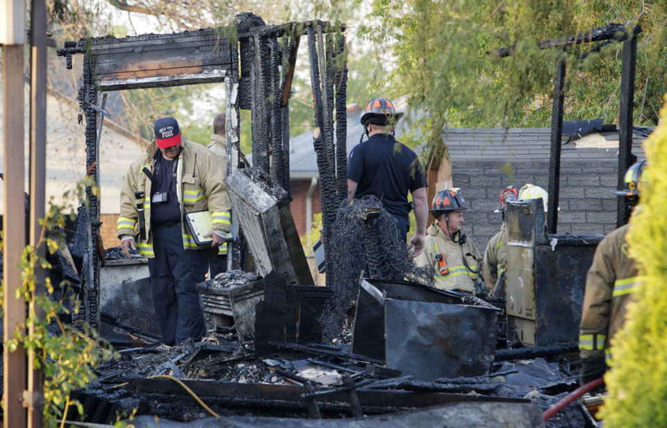 Photo -  Oklahoma City firefighters investigate a fatal house fire Tuesday at 1310 SW 23 in Oklahoma City. Photo by Paul B. Southerland, The Oklahoman   PAUL B. SOUTHERLAND -