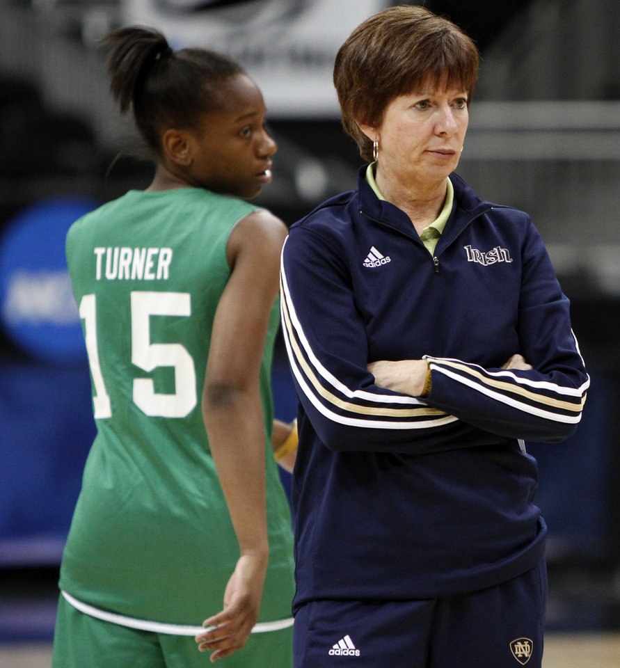 Photo - Notre Dame coach Muffet McGraw stands beside Kaila Turner during practice in Kansas City, Mo., on Saturday, March 27, 2010. The University of Oklahoma will play Notre Dame in the Sweet 16 round of the NCAA women's  basketball tournament on Sunday.