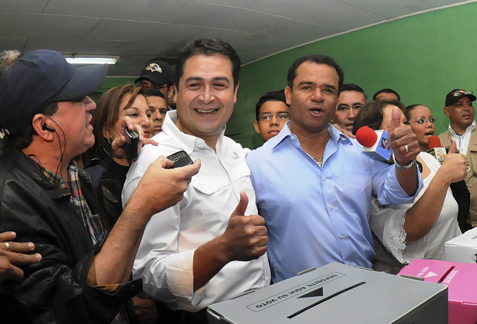 Juan Orlando Hernandez, center, of the National Party gestures after casting his vote during his party's primary elections in Tegucigalpa, Honduras, Sunday Nov. 18, 2012. The political parties of Honduras are holding primary elections as a third party is trying to break the country's 114- year-old two party system. (AP Photo/Fernando Antonio)