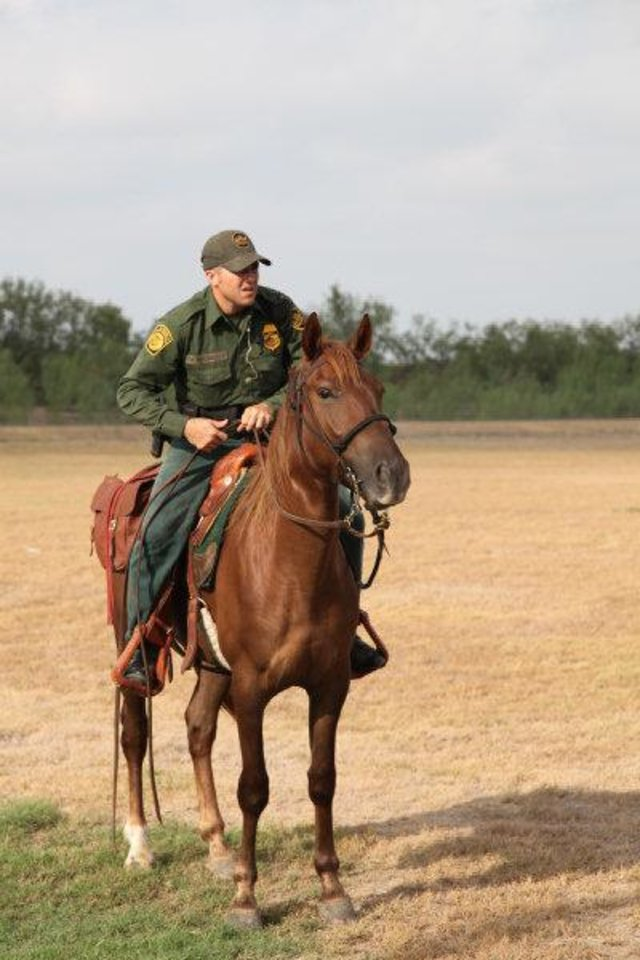 Border Patrol Agent J. DeLeon rides Junior, a mustang that was trained by inmates and adopted several months ago. PHOTO PROVIDED