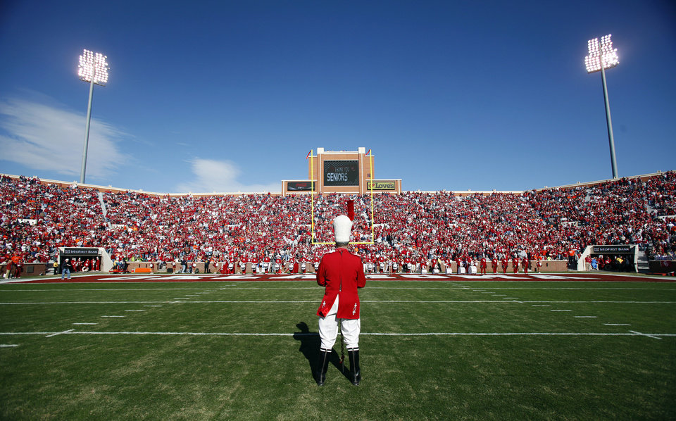 Photo - Pride of Oklahoma drum major stands on the field before the start of the Bedlam college football game between the University of Oklahoma Sooners (OU) and the Oklahoma State University Cowboys (OSU) at the Gaylord Family-Oklahoma Memorial Stadium on Saturday, Nov. 28, 2009, in Norman, Okla.Photo by Chris Landsberger, The Oklahoman