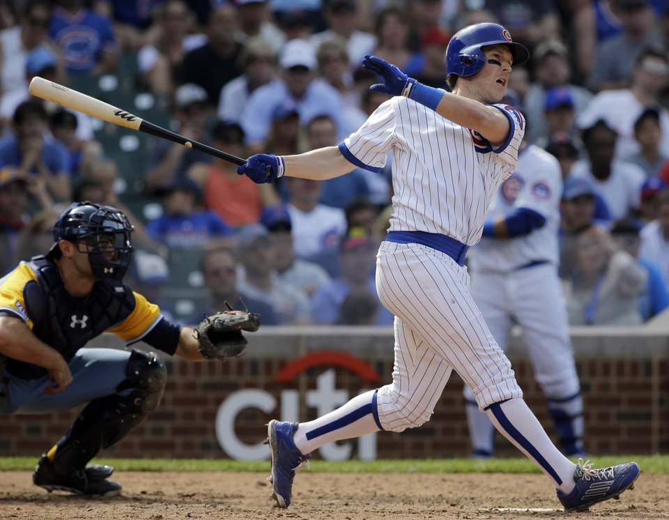 Photo - Chicago Cubs' Chris Coghlan, right, hits an one-run triple during the seventh inning of an interleague baseball game against the Tampa Bay Rays in Chicago, Sunday, Aug. 10, 2014. (AP Photo/Nam Y. Huh)
