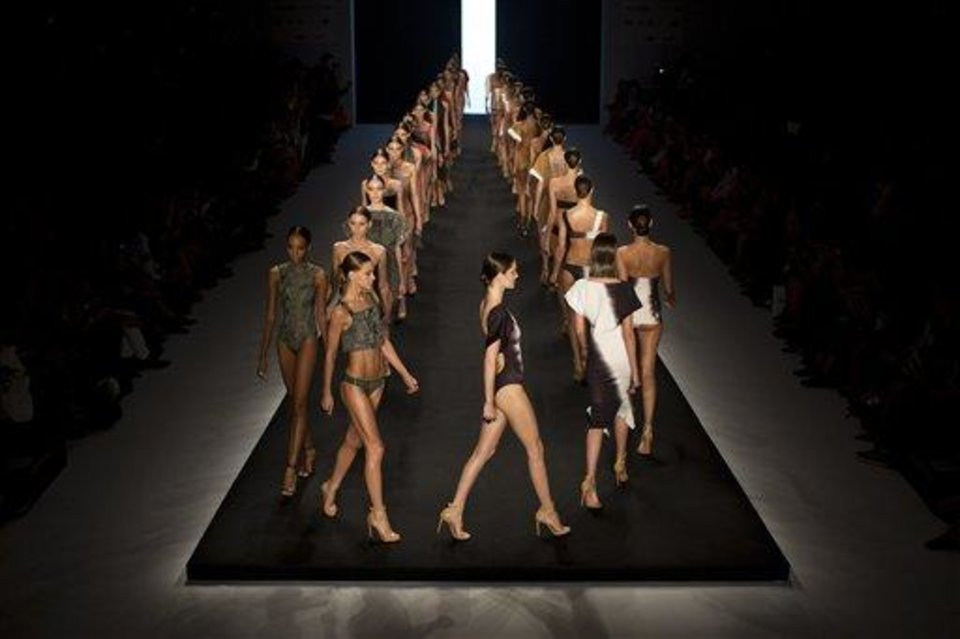 Photo - Models wear creations from the Lenny summer collection during Fashion Rio in Rio de Janeiro, Brazil, Wednesday, April 17, 2013. Known for her use of muted earth tones and the clean, almost architectural lines of her swimwear, Lenny Niemeyer sells some 350,000 pieces a year, mostly at her 26 boutiques throughout the country, but also at multi-mark shops in Britain, France, the Bahamas and in 23 U.S. states. (AP Photo/Felipe Dana)