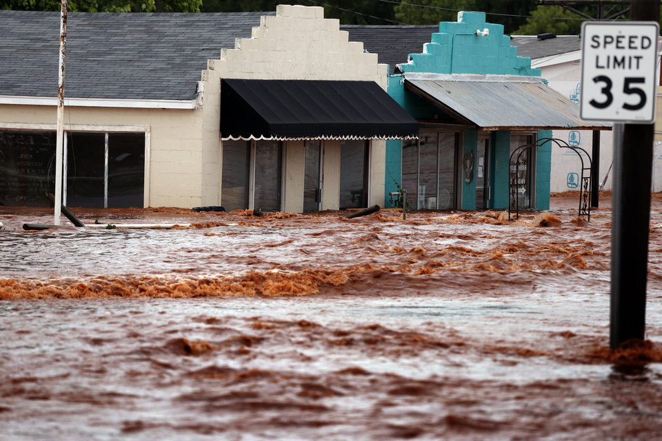 Photo - Water from Saturday night's storms rose to flood business on Sunday, May 24, 2015 in Purcell, Okla.  Photo by Steve Sisney The Oklahoman